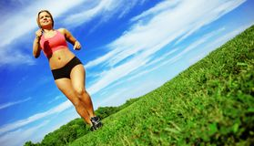 Runner Woman. Pretty woman running in a spring meadow royalty free stock images