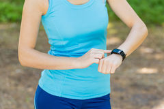 Runner woman arms with heart rate monitor, fitness woman checkin Stock Photography