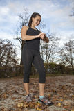 Runner woman checking  time and pulse rate Stock Images