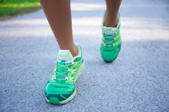 Runner woman feet running on road Royalty Free Stock Photography