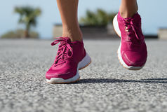 Runner woman feet running on road training. For fitness and healthy lifestyle Royalty Free Stock Photos