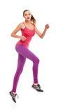 Runner woman full length jumping Stock Image