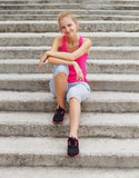 Runner woman have a rest after outdoor workout Stock Image