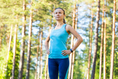 Runner woman with heart rate monitor ready for running in forest Stock Images