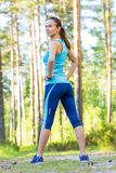 Runner woman with heart rate monitor ready for running in forest Royalty Free Stock Image