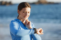 Runner woman with heart rate monitor running on beach Stock Photography