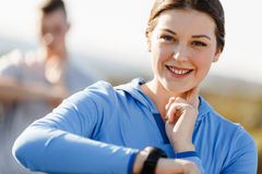 Runner woman with heart rate monitor running on beach Royalty Free Stock Images