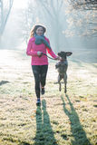 Runner woman and her cute German pointer dog running together Royalty Free Stock Photo