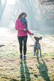 Runner woman and her cute German pointer dog running together Royalty Free Stock Photos