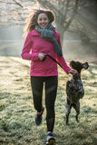 Runner woman and her cute German pointer dog running together Royalty Free Stock Photography