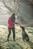 Runner woman and her cute German pointer dog running together Stock Photo