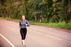 Runner woman jogging in nature outdoor Royalty Free Stock Images