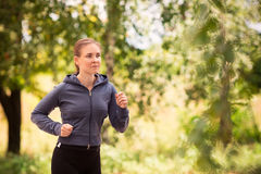 Runner woman jogging in nature outdoor Stock Image