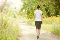 Runner woman jogging outdoors Royalty Free Stock Photography