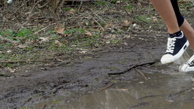 Runner woman jogging  through puddles. stock footage