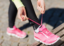 Runner woman lacing trainers shoes Stock Photo