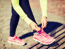 Runner woman lacing trainers shoes. Sport, fitness, exercise and lifestyle concept - runner woman lacing trainers shoes Royalty Free Stock Photo