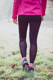 Runner woman legs on winter track, healthy lifestyle Royalty Free Stock Image