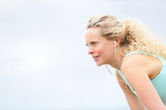 Runner woman resting after running workout Stock Image