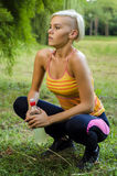 Runner woman resting, taking break. Outdoors Stock Image