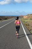 Runner woman running on mountain road Royalty Free Stock Images