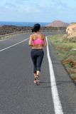 Runner woman running on mountain road Stock Photo