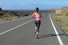 Runner woman running on mountain road Royalty Free Stock Photo