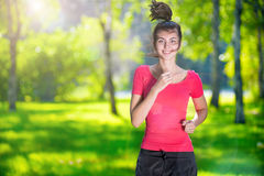 Runner - woman running outdoors in green park Royalty Free Stock Photos