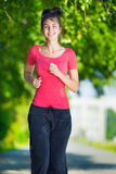 Runner - woman running outdoors in green park Stock Photo