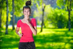 Runner - woman running outdoors in green park. Young woman running outdoors in green park at lovely sunny summer day. Jogging Royalty Free Stock Photography