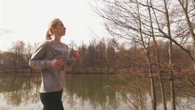 Runner woman running in park exercising outdoors fitness stock video