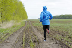 Runner woman running on road in beautiful nature. Jogging traini Royalty Free Stock Photos