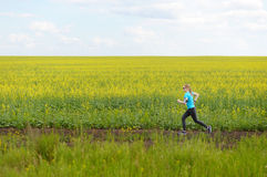 Runner woman running on road in beautiful nature. Royalty Free Stock Image