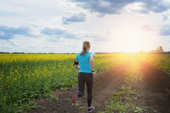 Runner woman running on road in beautiful nature. Royalty Free Stock Photography
