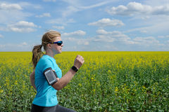 Runner woman running on road in beautiful nature. Stock Photography