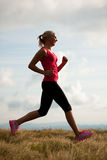 Runner - woman runs cros country on a path in early autumn Stock Photography