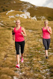 Runner - woman runs cros country on a path in early autumn Stock Photos