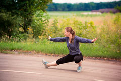 Runner woman stretching in nature outdoor Royalty Free Stock Photo
