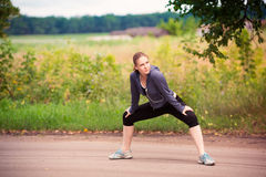Runner woman stretching in nature outdoor Royalty Free Stock Photos