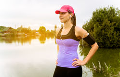 Runner woman stretching a pier. At sunset Stock Photography
