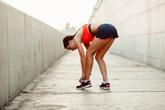 Runner woman  tie laces Royalty Free Stock Images