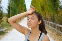 Runner woman tired after running in the park.  stock image