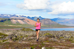 Runner woman trail running in nature Stock Image