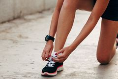 Runner woman tying laces closeup Royalty Free Stock Photo