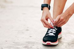 Runner woman tying laces closeup Royalty Free Stock Photos