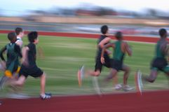 Runners. High school fast track runners, motion blur Stock Image