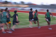 Runners. High school fast track runners, motion blur Stock Photography