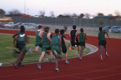 Runners. High school fast track runners, motion blur Stock Images