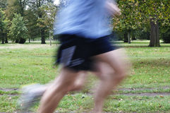 Runners. Two people running in Hyde park, London Royalty Free Stock Photos