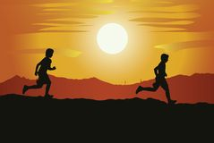 Runners. Running teenagers on a background of a sunset Stock Photo